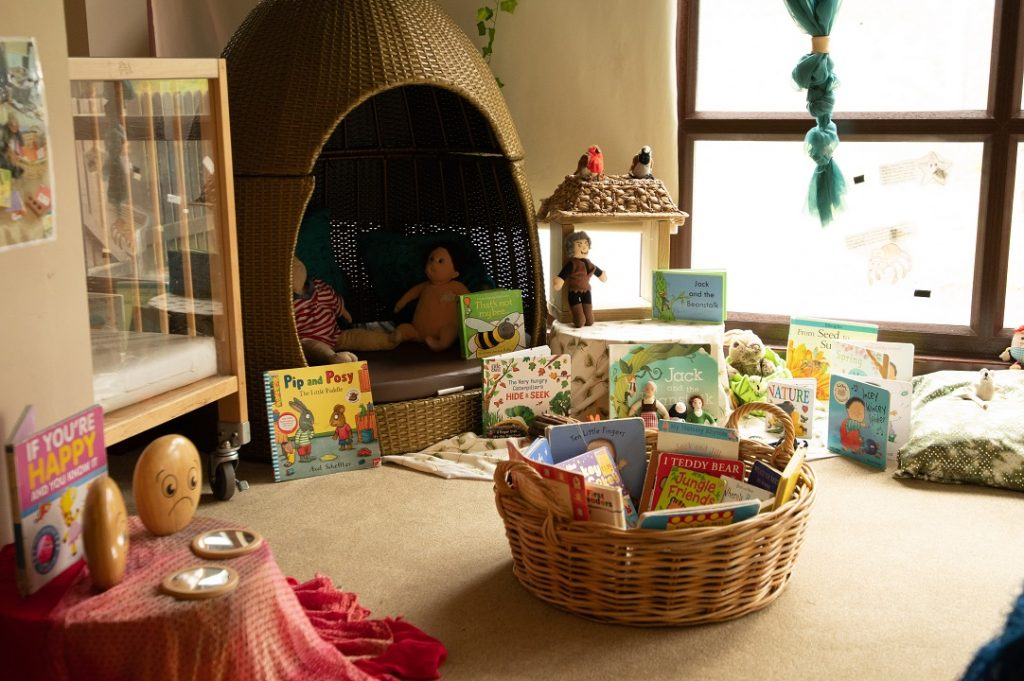 Children's play area, books and tent